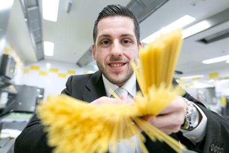 chef holding pasta